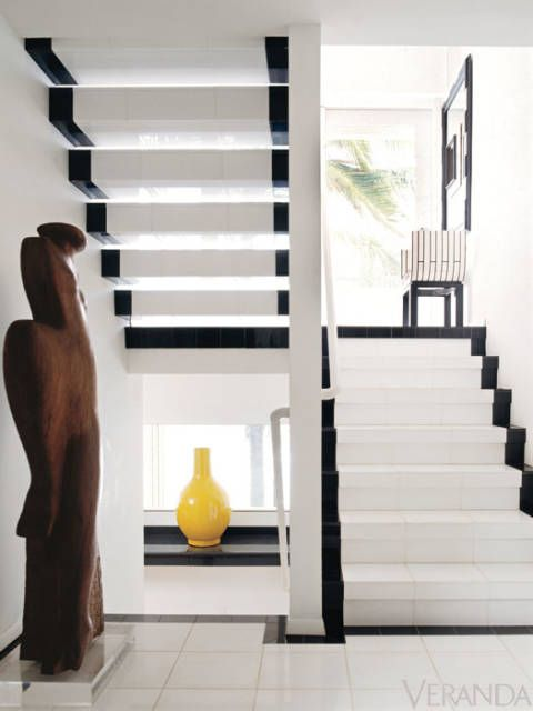 <p>This black and white stairwell is one of the many striking spaces in the home of late designer Geoffrey Beene. The white area emphasizes incoming light, which connects the straight-edged modern design to Hawaii's sunny atmosphere. The basic palette also allows the yellow piece and wooden sculpture to stand out. <em>(As seen in our April 2011 issue)</em></p>