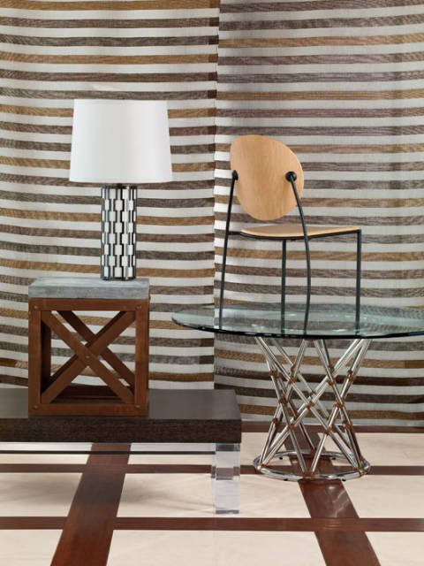 """<p><b>Clockwise from bottom left:</b><p> <a href=""""http://www.allanknightasso.com/"""" target=""""_blank"""">Allan Knight</a> expands on his acrylic oeuvre with the Gonzalo Cocktail Table. Its acrylic base is topped with cerused oak. Above it is <a href=""""http://www.bobointriguingobjects.com/"""" target=""""_blank"""">BoBo Intriguing Objects'</a> Bluestone Side Table. Made of Belgian stone, it is paired with a waxed, rust-iron base. <a href=""""http://www.boydlighting.com/"""" target=""""_blank"""">Boyd Lighting's</a> Kyoto encloses white glass in an architecturally styled, solid brass casing. A maestro of minimalism, <a href=""""http://www.dakotajackson.com/"""" target=""""_blank"""">Dakota Jackson</a> updates the stacking chair with his Vik-ter II Series, composed of solid maple with matte black finish steel legs. <a href=""""http://www.mcguirefurniture.com/"""" target=""""_blank"""">McGuire</a> updates the classic rattan table with its 54"""" Heritage Pedestal table—a mix of glass, polished nickel and leather.   <p><b>Foreground:</b></p> <a href=""""http://www.renaissancetileandbath.com/"""" target=""""_blank"""">Renaissance Tile & Bath's</a> exclusive Winslow Series Sheridan Cream Honed Limestone is squared off with <a href=""""http://www.wideplankflooring.com/"""" target=""""_blank"""">Carlisle Wide Plank Floors'</a> hickory.   <p><b>Background:</b><p>Nobilis'</a> """"Mustic Bay"""" is an über-stylish silver mesh, interspersed with handwoven cork to combine the expression of the hand with that of the machine.</p>"""