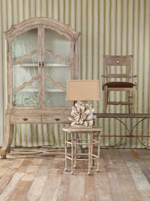 """<p><b>Clockwise from top left:</b></p> <a href=""""http://www.davidiatesta.com/"""" target=""""_blank"""">David Iatesta's</a> Danish Cabinet adds a dash of old-world Euro-style with its restoration glass and gray finish. <a href=""""http://www.lorts.com/"""" target=""""_blank"""">Lorts'</a> slate-finish alder chair achieves a weathered look that belies its subtle, metallic undertones. It sits atop <a href=""""http://www.bausman.net/"""" target=""""_blank"""">Bausman's</a> Iron Console Table, which combines a rust-finish base with a natural oak barrel top. <a href=""""http://www.pearsoncompany.com/"""" target=""""_blank"""">Pearson</a> hand-planes its mahogany side table with bamboo-style legs to create a worn look in distressed gesso. <a href=""""http://www.piercemartin.com/"""" target=""""_blank"""">PierceMartin's</a> Oyster Cluster Lamp was inspired by a cluster on discarded rebar. Designer Stephen Woods adds a limestone base and burlap shade but stays true to nature's intent."""