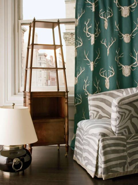 "<p>Cohler's Tang lamp for <a href=""http://www.visualcomfort.com/"" target=""_blank"">Visual Comfort</a>, Bruce étagère for MacRae, ""Antler"" fabric from <a href=""http://www.leejofa.com/"" target=""_blank"">Lee Jofa's</a> Lodge collection and Cohler's Sasha chair for Lee Jofa in designer's ""Dinisen Linen.""</p>"