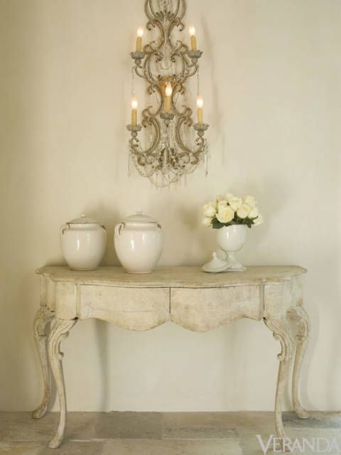 "These antique sconces from <a href=""http://www.watkinsculver.com/"" target=""_blank"">Watkins Culver</a> are the perfect example of how a large-scale piece can add drama to simple spaces while creating soft, romantic lighting."