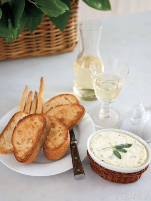 <p>1 pound fresh whole-milk ricotta cheese</p> <p>2 tablespoons Pecorino Romano cheese</p>  <p>2 tablespoons fresh chives, chopped</p> <p>2 tablespoons fresh oregano, chopped</p> <p>salt and pepper to taste</p>  <p>2 tablespoons walnut oil</p> <p>toasted walnuts (optional)</p> <p>crostini or grilled bread</p>   <p>Preheat oven to 300°. Lightly oil an ovenproof dish large enough to hold mixture. Mix cheeses, herbs, salt and pepper with fork until smooth. Drizzle with walnut oil and bake about 15 minutes. Sprinkle with toasted walnuts (optional) and serve hot with prepared bread.</p>
