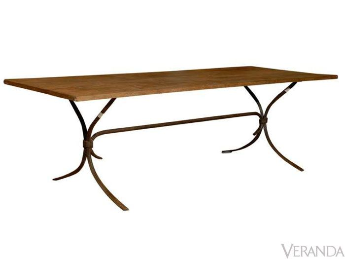 """<p>Since 1896, four generations of the Holland family have been supplying interior designers with decorative European antiques, aged reproductions, and reclaimed industrial pieces, like the Katherine Dining table with a hand-hammered iron base and reclaimed honey-brown wood top.</p> <p>Katherine Dining Table, <a href=""""http://www.beauhollandstudio.com"""">beauhollandstudio.com</a></p>"""