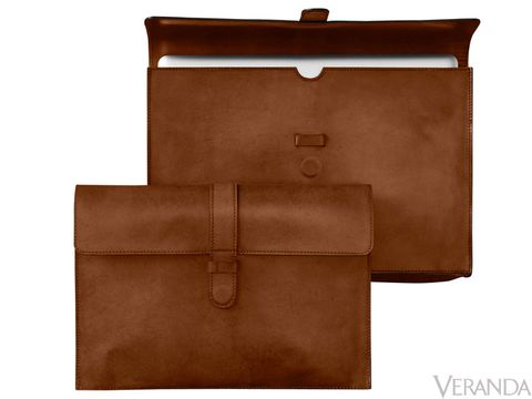 "<p>This soft, chocolate brown sleeve proves that laptop cases don't need to be bulky or dull. The topstitching creates a clean, tailored look, while the magnetic closure makes it easy to close—perfect for business trips. $109-$119</p> <p> </p> <p><strong>Dimensions:</strong><br /> Small (for 13"" MacBook®): 13¾""L x 2""W x 9¾""H<br /> Large (for 15"" MacBook®): 15½""L x 2""W x 10½""H</p>"