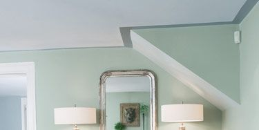 Antique mirror. Horchow buffet. Lamps from Aero.