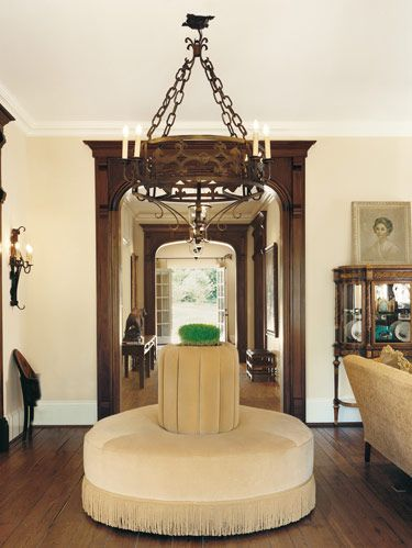 In foyer, DES-SYN roundabout in Kravet velvet with Bargia fringe. Scrap-iron chandelier by Erin O'Brien of Iron Design. French 19th-c. chair.
