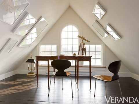 <p>Carter gives a sparse attic room a styled look with an array of artworks hung, surprisingly, on the angled ceiling. The matching white frames, tonal prints, and casual arrangement don't overwhelm the nook.</p>