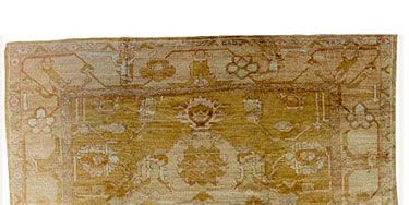 <p>With their loose, large weave, oushaks have become Maloney's go-to floor covering for creating contrast in a formal room.</p>