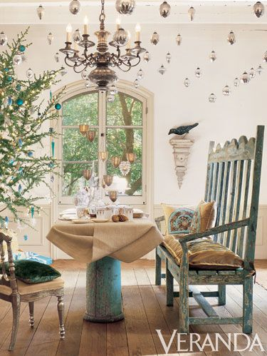 <p>There's something magical about dining under the stars, which this private residence recreated with a constellation of silver ornaments twinkling from the ceiling. The delicate gold-and-white table setting complements the subtle patina of the Indian silver chair, antique wooden settle, and rough-hewn floors.</p> <div> </div>