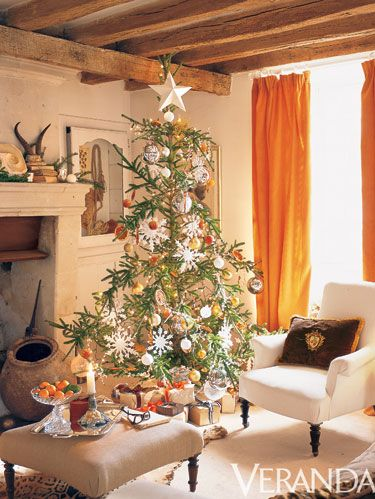 <p>In his sixteenth-century home in France's Loire Valley, San Francisco designer Stephen Schubel leaves no room unadorned. He extends the Christmas spirit into the master bedroom with a simple wreath and modest Christmas tree decorated with small glass balls and a paper star.</p>