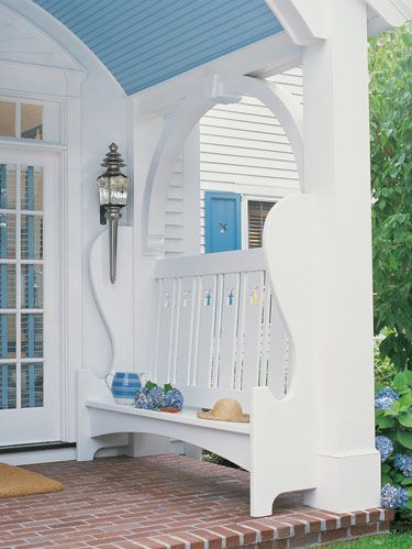 Designers William Diamond and Anthony Baratta made structural changes to the home, adding a front porch with built-in benches and antique carriage lanterns.