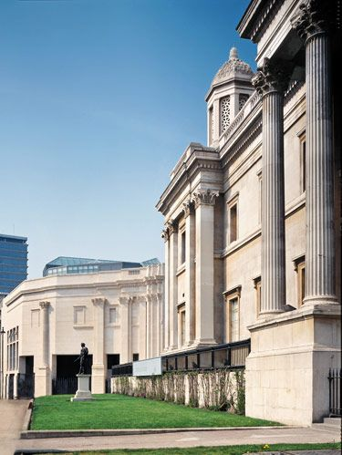 Distant facade of Sainsbury Wing of London's National Gallery acknowledges the older structure in the foreground by using modernized faux columns and filled-in windows
