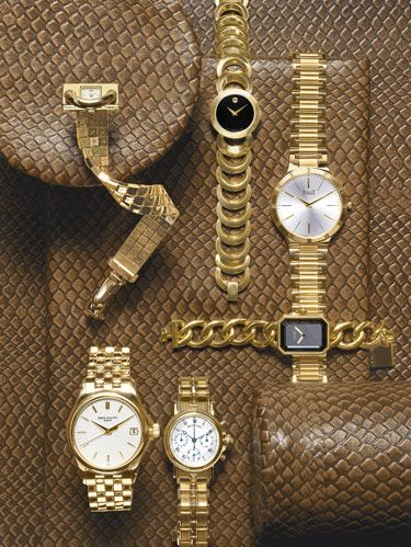 "Clockwise, from top left: Van Cleef & Arpels' uniquely styled Cadenas watch in yellow gold. Movado's Rondiro watch with black museum dial and 18k goldplated stainless steel case. Piaget's classic round Dancer watch in 18k yellow gold. Chanel's 18k gold Premier watch. Breguet's Marine Chronograph with 18k yellow gold case and bracelet. Patek Philippe's 18k gold Calatrava watch with opaline white dial. background: Edelman Leather's aniline-dyed cowhide ""Old Rattlesnake."""