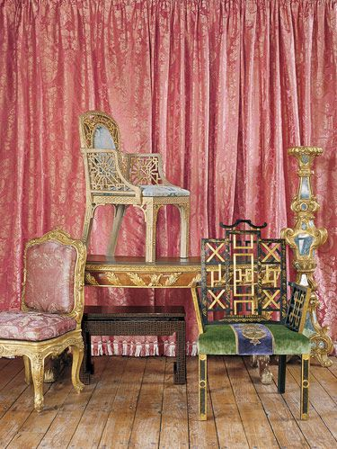 From the Ann Getty House Collection, Louis XV side chair, Winter Garden Chair atop Acanthus Leaf Writing Desk. Bench is Asian lacquerware. Badminton Chair. Large gilded torchère. Period fabric from England in background.