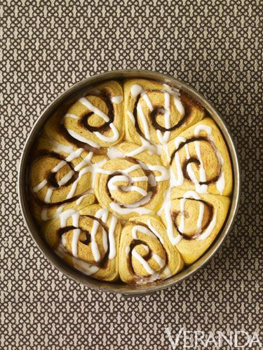 "<p><strong>Kaitlin:</strong> This recipe is everything you could ever want in a cinnamon roll, and more—a sticky pumpkin dough with a gooey filling of seasonal spices and a tangy-sweet buttermilk and cream cheese icing. I made them on the first cold fall morning, served with a cup of strong coffee—and now I can't help but long for one each morning as my feet hit the cold wood floor.</p> <p><strong>Matt and Renato:</strong> America's food courts and highway rest stops are filled with myriad oddities and vast collections of the absurd—bizarre fast food chains that wouldn't survive outside the protective womb of a mall or the glamless oasis of a roadside pit stop—but even in these locales, a shop dedicated to a single breakfast item (oversized cinnamon rolls) seems slightly alien. Yet we find ourselves transfixed by the store, its yeasty, cinnamon aroma lulling its followers into a trancelike state. How is this a business concept? How many cinnamon rolls can one person eat in a given year? Why aren't there more flavors? None of these questions matter as we place our order, hearts beating erratically in anticipation. Our Pumpkin Cinnamon Rolls were created partly as an ode to this chain store, a chain store beloved by Renato. They are surprisingly simple to put together and highly impressive to serve for a Sunday brunch.</p> <p><strong>Baking Note:</strong> You can make the bulk of this recipe the night before. Once the rolls are sliced and in the pan, cover them with two tight layers of plastic wrap and refrigerate them. In the morning, remove the pan from the refrigerator and proceed with the recipe as normal; however, make sure you allow sufficient time for the dough to come to room temperature and rise properly.</p> <p><strong><em> </em></strong></p> <p><strong><em>Yield: 10 to 12 rolls</em></strong></p> <p><strong><em> </em></strong></p> <p><strong>For the Pumpkin Dough:</strong></p> <p>3 1⁄2 cups bread flour<br />1⁄4 cup granulated sugar<br />1⁄4 cup firmly packed dark brown sugar<br />1 tablespoon instant dry yeast<br />1 teaspoon salt<br />1⁄2 teaspoon cinnamon<br />1⁄4 teaspoon ground ginger<br />1⁄4 teaspoon ground cardamom<br />3 ounces (3⁄4 stick) unsalted butter, softened, cut into 1⁄2-inch cubes<br />2⁄3 cup whole milk<br />1 large egg<br />2⁄3 cup pumpkin puree</p> <p><strong><em> </em></strong></p> <p><strong>For the Cinnamon Filling:</strong></p> <p>3⁄4 cup firmly packed light brown sugar<br />1⁄4 cup granulated sugar<br />1⁄2 teaspoon cinnamon<br />1⁄4 teaspoon ground cloves<br />1⁄4 teaspoon freshly grated nutmeg<br />1⁄4 teaspoon salt<br />1 ounce (1⁄4 stick) unsalted butter, melted</p> <p> </p> <p><strong>For the Assembly:</strong></p> <p>1 ounce (1⁄4 stick) unsalted butter, melted</p> <p> </p> <p><strong>For the Cream Cheese Frosting:</strong></p> <p>2 ounces cream cheese, softened<br />3 tablespoons well-shaken buttermilk<br />1 1⁄4 cups confectioners' sugar, sifted</p> <p> </p> <p><strong>Steps:</strong></p> <p>1. <span style=""text-decoration: underline;"">Make the pumpkin dough:</span></p> <p>Butter one 10-inch round cake pan, line the bottom with parchment paper, and butter the parchment. Dust the parchment with flour and knock out the excess flour. In the bowl of a standing mixer fitted with the paddle attachment, mix the flour, sugars, yeast, salt, cinnamon, ginger, and cardamom on medium speed. Add the butter and mix until incorporated, about 1 minute. Add the milk and egg and mix on low speed until incorporated. Add the pumpkin puree and mix on medium speed for 3 minutes. The dough will be light orange in color and feel soft and sticky. Remove the dough from the bowl, carefully form it into a large ball, smooth the top with your hands, and place it in a clean, lightly greased bowl. Cover with plastic wrap and let the dough rest for 30 minutes. Meanwhile, make the filling.</p> <p> 2. <span style=""text-decoration: underline;"">Make</span><span style=""text-decoration: underline;""> the cinnamon filling:</span></p> <p>In a small bowl, stir together the sugars, cinnamon, cloves, nutmeg, and salt. Add the melted butter and stir until combined.</p> <p> <em>3. </em><em><span style=""text-decoration: underline;"">Assemble the rolls:</span></em></p> <p>Dust a work surface with a sprinkling of flour. Using a rolling pin, roll the dough into a large rectangle approximately 20 by 10 inches, brush the dough with half the melted butter, and sprinkle the filling over the butter, leaving a 1⁄4-inch border around the edges. Use the palms of your hands to press the filling lightly into the dough. Roll up the long side of the rectangle to form a tight log and place it seam side down. Slice the log into ten 2-inch rolls. Place one roll in the center of the cake pan, then fill in the rest of the pan with the other rolls. Brush the tops of the rolls with the remaining melted butter, cover with plastic wrap, and set aside until the rolls have almost doubled in size, about 45 minutes.</p> <p> 4. Preheat the oven to 350°F and position the rack in the center.</p> <p> 5. Bake for 25 to 30 minutes, or until the tops of the rolls are browned. In order to pour your icing over still-warm rolls for the best effect, prep all the frosting ingredients while the rolls are baking and put together the frosting (this will only take about 5 minutes) immediately after the rolls come out of the oven.</p> <p> 6. <span style=""text-decoration: underline;"">Make the frosting:</span></p> <p>In the bowl of a standing mixer fitted with the paddle attachment, beat the cream cheese and buttermilk on medium speed until the mixture is lump free. Add the confectioners' sugar and beat on medium-low speed until a smooth, fluid mixture forms.</p> <p>7.<span style=""text-decoration: underline;""> Serve the rolls:</span></p> <p>Invert the pan of rolls onto a serving plate or leave them in the pan for a rustic look. Pour the frosting over the warm rolls. It's okay if a little bit of the frosting drips down the sides—it's even encouraged. Serve immediately.</p>"