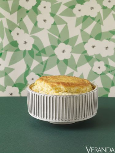 <p><strong><br /></strong></p> <p><strong>Kaitlin:</strong> Taking Matt and Renato's advice, I served this soufflé for brunch, with roasted new potatoes and a frisee salad. They're right, it was a lot of early-morning prep, but it was also a smash hit!</p> <p><strong>Matt and Renato:</strong> Yes, this incredibly rich, creamy, Cheddar Corn Souffle can be served as a dessert—a studious, old-school cheese course. It can also be served as an appetizer. We actually encourage you, if you are feeling full of morning pep, to try it out on unsuspecting breakfast or brunch guests. Our riff on this venerable dish is punched up with the decidedly unsubtle extra-sharp cheddar (we have classic macaroni and cheese on the brain) and a handful of corn—the two flavors complement each other well, and the corn adds a bright burst of texture. Finally, we think our perfectly golden Cheddar Corn Souffle is one of those dishes that fancifies the mood with little effort, and everyone knows we could use a bit more fancy in our lives.</p> <p><em> </em><strong></strong></p> <p><strong>Yield: 6 main-dish or 10 side-dish servings</strong></p> <p><strong><em> </em></strong></p> <p><strong>Ingredients:</strong></p> <p>2 tablespoons finely grated fresh<br />Parmesan cheese<br />1⁄2 teaspoon salt<br />1⁄2 teaspoon freshly grated nutmeg<br />1⁄2 teaspoon freshly ground black pepper<br />1⁄4 teaspoon ground cayenne<br />1 cup whole milk<br />2 ounces (1⁄2 stick) unsalted butter<br />1⁄4 cup all-purpose flour<br />5 large eggs, separated, plus 1 large egg white, at room temperature<br />3⁄4 teaspoon cream of tartar<br />1 cup packed grated extra-sharp cheddar cheese (about 4 ounces)<br />1⁄2 cup fresh corn kernels or frozen corn, thawed</p> <p> </p> <p><strong>Steps:</strong></p> <p>1. Preheat the oven to 400°F and position the rack in the center. Lightly butter the bottom and sides of a 1 ½-quart soufflé dish. Dust the soufflé dish with the Parmesan cheese (so that it adheres to the butter) and knock out the excess. In a small bowl, whisk together the salt, nutmeg, black pepper, and cayenne. Set aside.</p> <p>2. In a medium saucepan over medium heat, warm, but do not boil, the milk. Remove from heat once tiny bubbles appear around the pan's perimeter.</p> <p>3. In a medium, heavy-bottomed saucepan, melt the butter. Add the flour and whisk until completely combined, 2 to 3 minutes. Remove from the heat, wait 30 seconds, then slowly stream the milk into the butter mixture while whisking constantly. Continue whisking until smooth, and return to the heat. Cook until the mixture bubbles and becomes thick, 8 to 10 minutes. When bubbles appear, remove from the heat and whisk in the spice mixture. Continue stirring vigorously for about 1 minute to release some of the heat. Add the 5 egg yolks, one at a time, whisking after each addition. After all the yolks are completely incorporated, transfer the mixture to a large bowl.</p> <p>4. In another large bowl (or in the bowl of a standing mixer fitted with the whisk attachment), whisk the 6 egg whites vigorously for 1 minute. Sprinkle the cream of tartar over the whites and continue beating until the egg whites form stiff peaks.</p> <p>5. Fold one-third of the egg white mixture into the soufflé base. Add the cheddar cheese and corn, along with half of the remaining egg whites, and gently fold until almost incorporated. Gently fold in the remaining egg whites until completely but just incorporated.</p> <p>6. Transfer the entire mixture to the prepared soufflé dish. Run your thumb around the inside edge of the dish to wipe away any stray mixture (this will provide for an even rise), place the soufflé in the oven, and immediately reduce the oven temperature to 375 degrees F. Bake for 30 to 35 minutes, or until the soufflé is puffy, slightly golden, and the center is just about set.</p> <p>7. Transfer the soufflé dish to a serving platter and serve immediately.</p>