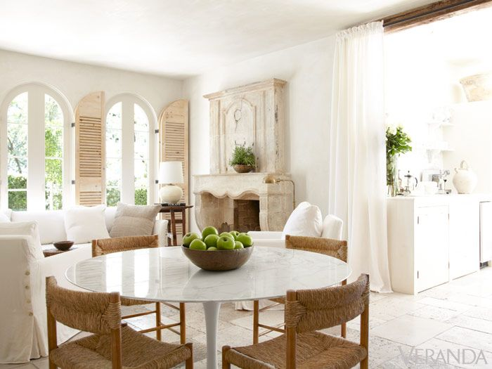 White Interior Design Ideas: French Country living room decor with white sofa, Saarinen table, and French limestone fireplace. Pamela Pierce Houston Home. #interiordesign #decoratingideas #livingroomdecor #pamelapierce