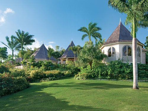 Bambu Villa features indoor-outdoor pavilions and conical roofs typical of many Jamaican homes.
