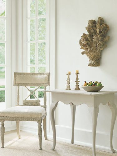 Swedish chair, c.1800, in muslin. Dutch 18th-c. table. Antique French sculpture on wall. Oushak rug, c.1920.