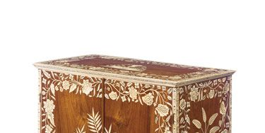 Intricate ivory inlay on cabinet, 1770, shows a high level of craftsmanship that has contributed to the popularity of Anglo-Indian furniture in recent years.
