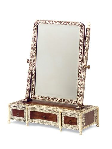 This mirror was made to sit atop a dressing table.