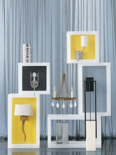 """<p><b>CLOCKWISE FROM TOP LEFT:</b> A brushed steel finish wraps frosted glass in Visual Comfort's Primitive Sconce, designed by Clodagh. Vaughan's one-arm Twig wall light in nickel. Satori's Eva sconce in Heian bronze finish with Banirra washi fused to shade. Fourteenth Colony's unfinished galvanized steel sconce with ribbed glass. Porta Romana's burnished gold Ribbon wall light. Jonathan Browning's polished nickel Chapelle sconce with an oval magnifying glass shielding bulb. <b>CENTER: </b>Ironware International's hammered Sonia sconce with reeded strapwork and sandblasted bead and teardrop crystals. <b>BACKGROUND FABRIC: </b>Création Baumann's """"Sinfonia"""" sheer in 210. </p>"""