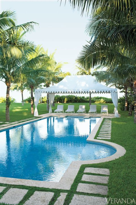 Swimming pool, Resort, Woody plant, Arecales, Azure, Garden, Composite material, Shade, Water feature, Palm tree,