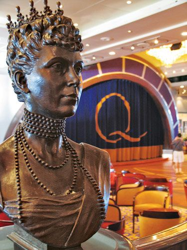Aboard the Queen Mary 2, the Queens Room, with its royal family memorabilia and bronze bust of the ship's  namesake, boasts the largest ballroom at sea.