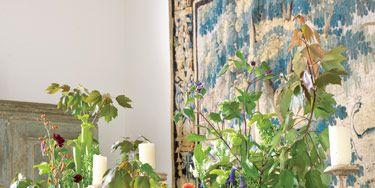 Antique stone planters from Chateau Domingue hold grapes, muscari, artichokes, dahlias, hydrangeas, euphorbias and sarracenias.