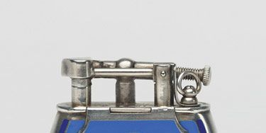 From David Golden's collection of antique lighters. Blue lacquer and silver lighter with engine-turned engraving.
