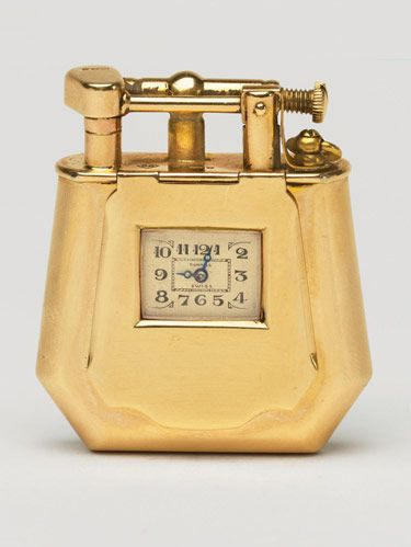 "Rare gold lighter. Both are ""fancy shape"" watch lighters, 1927, by Dunhill."