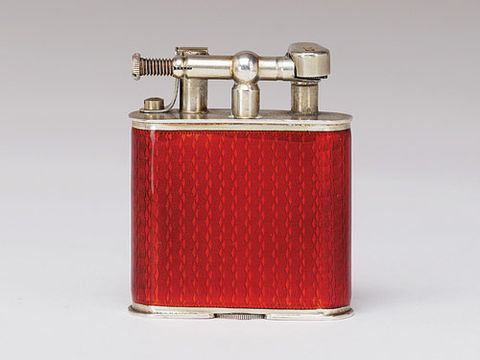 Red hard glass enamel and vermeil Dunhill lighter, c.1924-1925.