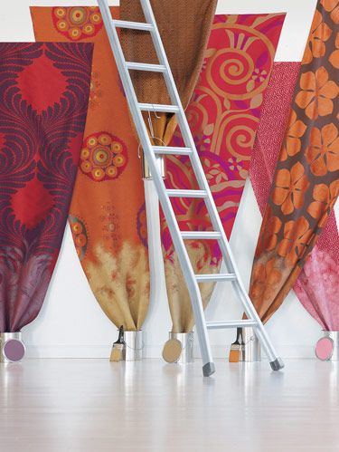 "<p>Autumn textiles reflect global vernaculars that borrow from African tribal motifs, Central Asia's bold and colorful suzanis and the spirited sensibility of Art Deco. They are manifest in complex textural combinations including velvets, metallic threads and large proportions. FROM LEFT: Dedar's overscale cotton/silk ""Acanthus"" in rosso colorway. Schumacher's acetate/silk ""Usak Weave"" with suzani medallions. Carole Fabrics' zigzag-patterned ""Sari"" in paprika. ""Legato Figured Woven"" overscale cotton blend Deco design by Kirk Brummel at Brunschwig & Fils. Clarence House's red ""Selvatico"" dotted cut velvet. ""Agemina"" ribbed-pile floral motif on cotton sateen ground designed by Lori Weitzner for Sahco. See Sources on page 248. </p>"
