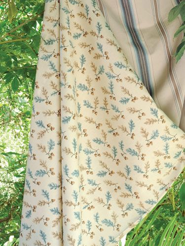 """Oak & Acorn"" linen/cotton and ""Bonaparte Stripe"" cotton/rayon in blue. Landscape design by Susan Van Adam."