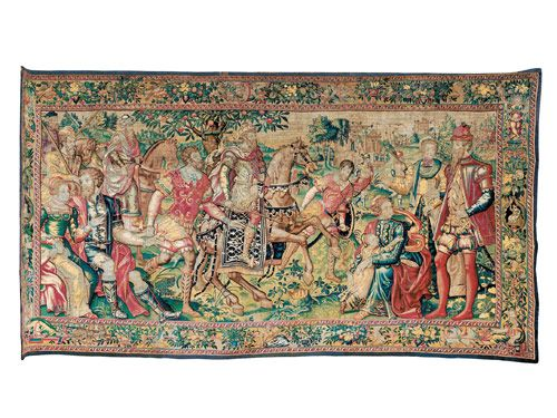 In this Brussels tapestry from the mid-16thc., couples are both courting and courtly. In the distance, soldiers proceed to a town under siege.