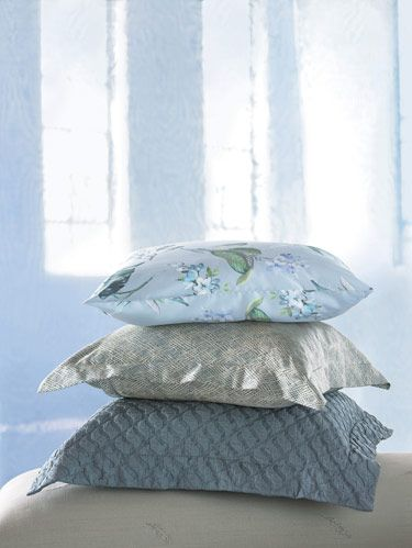 "FROM TOP: Schlossberg Switzerland's floral ""Eileen"" pillowcase. SDH's ""Rhapsody"" and ""Mino"" shams from its washable Organzino Silk Collection."