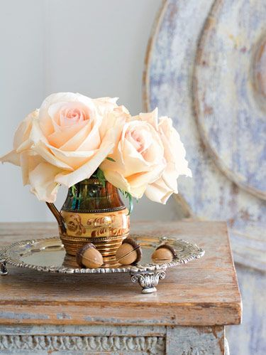 Acorn-shaped, dark chocolate and peanut butter Nottingham Nips on antique English tray. Roses in American lusterware.