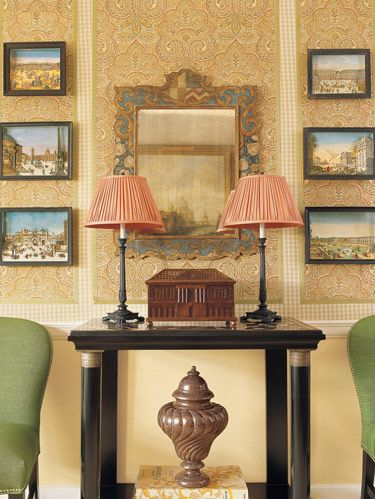 Antique mirror, console and dioramas from Charlotte Moss Interior Design. Vaughan lamps. Side chairs from Williams-Sonoma Home.