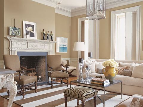 Louis XIII-style chairs and Verellen sofa, all upholstered in linen. Williams-Sonoma Home rug. Table by Oly. Edelman Leather fabric on William IV bench.