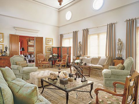National Upholstering Company sofas in Groves Bros. fabric and Donghia velvet. JJ Custom chairs in Osborne & Little stripe. Ralph Lauren suede ottoman. William Switzer chairs in Edelman Leather. Charles Chodoff table. Balinese figures on Biedermeier pedestals, Chinese screen and rug, all antiques. Draperies in Création Baumann stripe.