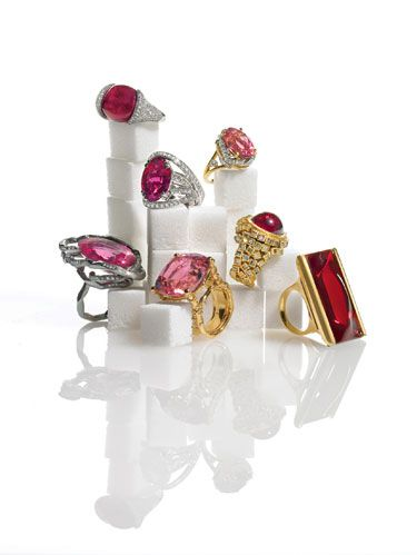 CLOCKWISE FROM TOP LEFT: Donna Vock's cabochon red spinel and pavé diamond ring in white gold and palladium. Oval pink tourmaline Leaf Wrap ring with diamonds in gold and platinum by Jean Schlumberger for Tiffany & Co. Todd Reed's rubellite and raw-diamond-cube ring in 18k gold. InsomNight pink Mordore crystal ring in 18k gold by Baccarat. Mish New York's rubellite Bili Bili ring with white and cognac diamonds in 18k gold. Mimi So's 45.46-carat pink tourmaline and diamond Gate B9 ring in 18k oxidized yellow gold. CENTER: Roberto Coin's Haute Couture rubellite ring with diamonds in 18k white gold.