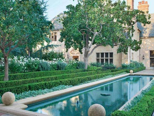 The estate features a large reflecting pool, rose gardens and a host of other lush outdoor settings.
