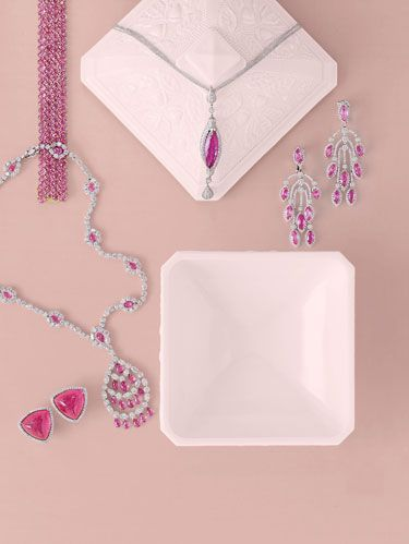 "<p>A deep-pink rubellite is really a red tourmaline.</p><p>Clockwise from Top Left: <a href=""http://www.paolocostagli.com""target=""_blank"">Paolo  			Costagli's</a> oval pink sapphire, 76.37 carats, bracelet in 18k gold. <a href=""http://www.donaldhuber.com""target=""_blank"">Donald Huber's</a>  			one-of-a-kind  Slick Collection pendant with 11.25-carat rubellite and diamonds in 18k white gold. Pink sapphire, 28.40  			carats, and diamond, 6.02 carats, chandelier earrings from <a href=""http://www.chopard.com""target=""_blank"">Chopard</a>. Graff's necklace with pink  			sapphire briolettes, 30.14 carats, and diamonds, 30.32 carats, in platinum. <a href=""http://www.valentinmagro.com""target=""_blank"">Valentin Magro's</a> 			carved pink tourmaline and pavé diamond earrings."