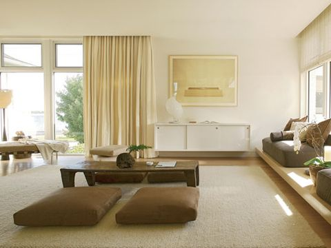 "<p>In the meditation studio, Mies van der Rohe chaise by <a href=""http://www.knoll.com"" target=""_blank"">Knoll</a> in Spinneybeck leather. A <a href=""http://www.citystudiola.com"" target=""_blank"">City Studio</a> floor lamp stands tall in front of the windows. <p><a href=""http://www.formplusfunction.com"" target=""_blank"">Form+Function</a> lamp on <a href=""http://www.thehardenhouse.com"" target=""_blank"">The Harden House</a> console. Photograph by Seiju Toda.</p> On the custom daybeds is a <a href=""http://www.donghia.com"" target=""_blank"">Donghia</a> sateen with pillows in <a href=""http://www.josephnoble.com/collections/"" target=""_blank"">Joseph Noble</a> fabric. Floor cushions in Joseph Noble and <a href=""http://www.coraggio.com"" target=""_blank"">Coraggio Textiles</a> fabrics.</p> <p>Asian antique table. Draperies in <a href=""http://www.pierrefrey.com"" target=""_blank"">Pierre Frey</a> cotton.</p> <p>A <a href=""http://www.starkcarpet.com"" target=""_blank"">Stark</a> rug unifies the elements of the room.</p>"