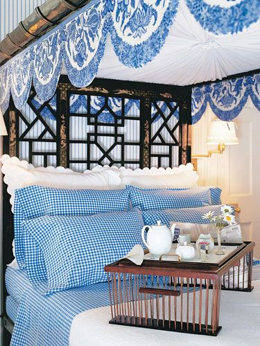 In a photo from Roehm's latest book, <i>A Passion for Blue & White</i>, breakfast is served in grand style on an eighteenth-century Chinese Chippendale guest bed.