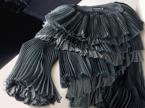 The structure and layers of Armani's Ruffle blouse serve as inspiration for the new collection.