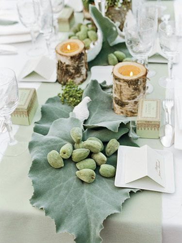 Bride Kelly d'Halluin's stylistic touches were evident in every detail. Here birch-bark vessels and porcelain doves adorn the table.