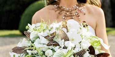 Stéphane Chapelle mixed butterflies from Deyrolle, grouse feathers, orchids, ferns, mint, and peonies tied with antique ribbons. The inspiration for the bouquet came from the curiosity cabinets upstairs in the château. d'Halluin was drawn to the very raw, rough features juxtaposed with a refined aesthetic.