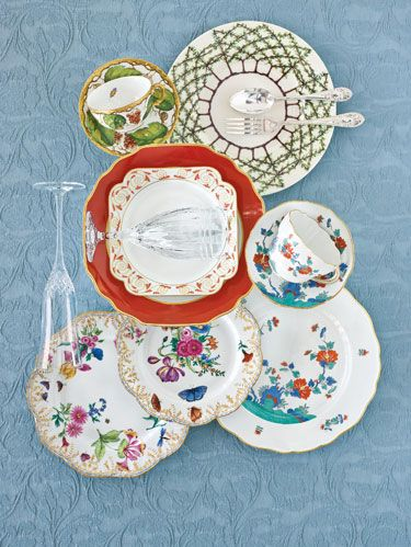 "<p>From top, left to right: <a href=""http://www.devinecorp.net"" target=""_blank"">Anna Weatherley's</a> handpainted ""Wildberry"" berry, butterfly and bug cup and saucer. Charlotte Moss' ""Espalier"" garden greenery plate for <a href=""http://www.pickardchina.com"" target=""_blank"">Pickard China</a> with <a href=""http://www.williamyeoward.com"" target=""_blank"">William Yeoward's</a> ""Anglesey"" silverplate flatware.</p><p>Center, left to right: <a href=""http://www.waterford.com"" target=""_blank"">Waterford Crystal's</a> ""Alana Essence"" diamond-cut champagne flute. <a href=""http://www.mottahedeh.com"" target=""_blank"">Mottahedeh's</a> ""Chinese Red"" dinner plate complemented by its ""Scroll Dessert"" service with <a href=""http://www.reedandbarton.com"" target=""_blank"">Reed & Barton's</a> linear-cut ""Tempo"" water glass. <a href=""http://www.meissen.com"" target=""_blank"">Meissen's</a> handpainted East Asian-inspired ""Persian Rose"" cup, saucer and plate.</p><p> Bottom, left to right: Two of <a href=""http://www.albertopinto.com"" target=""_blank"">Alberto Pinto's</a> ""Belles Saisons"" handpainted plates depicting the seasons. <a href=""http://www.meissen.com"" target=""_blank"">Meissen's</a> ""Persian Rose.""</p><p> Background: <a href=""http://www.sdhonline.com"" target=""_blank"">SDH's</a> Egyptian cotton ""Apollo."" </p>"