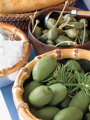 Rock sea salt, capers and green olives with a sprig of rosemary are the perfect seasonal touch.